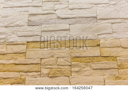 Brick background abstract weathered texture of stained old light brown stucco and painted red yellow brick wall background in rural room Grungy rusty blocks of stonework tech dark retro color architecture Wallpaper.