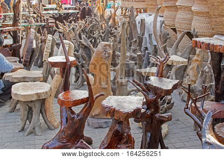 Chairs made of wood wooden handicrafts on display during the Handicraft Fair in Kolkata earlier Calcutta West Bengal India. It is the biggest handicrafts fair in Asia.