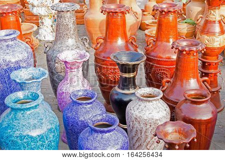 Colourful flower vases made of clay. Handicrafts on display during the Handicraft Fair in Kolkata earlier Calcutta West Bengal India. It is the biggest handicrafts fair in Asia.