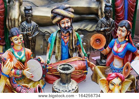 Colorful dolls and musical instruments made of clay handicrafts on display during the Handicraft Fair in Kolkata earlier Calcutta West Bengal India. It is the biggest handicrafts fair in Asia.