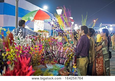 Kolkata West Bengal India - 28th November 2015 : Selling and buying of artificial flowers made out of colored plastics handicrafts on display during the Handicraft Fair in Kolkata. Biggest handicrafts fair in Asia.