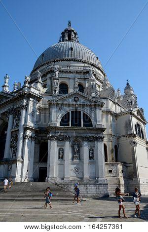 Venice Italy - September 9 2016: Basilica di Santa Maria della Salute in Venice Italy. Unidentified people visible.