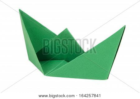 Green boat made of paper on a white background