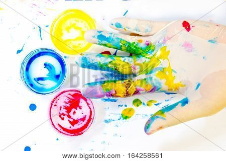 Paint mess of Primary colors on Hand Wearing gloves.
