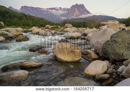 Scenic mount Kinabalu and rivers with stone views from iconic tropical Melangkap river,Kota Belud,Sabah,Borneo.