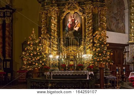 POLAND KRAKOW - JANUARY 01 2015: Side altar of the catholic monastery Church of Sts. Bernardine of Siena with Christmas decorations. The interiors of the church made in baroque style.