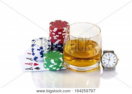Cards to poker and colorful chips with glass of whiskey