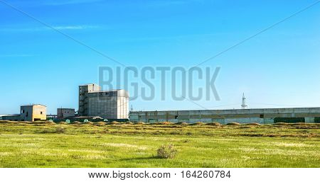 Cargo railway station. Old abandoned factory on foreground