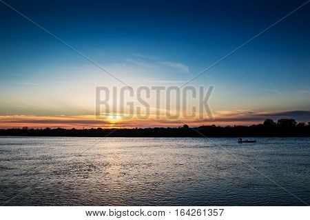 Fisherman's boat at beautiful sunset on the river