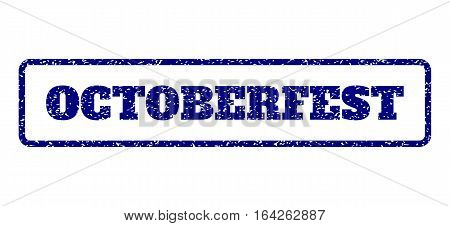 Navy Blue rubber seal stamp with Octoberfest text. Vector tag inside rounded rectangular banner. Grunge design and scratched texture for watermark labels. Horisontal sign on a white background.