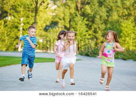 Group of excited preschoolers running