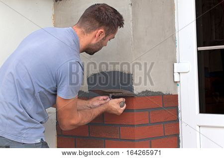 Man Cement Is Applied With A Trowel.