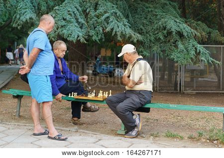ALUSHTA CRIMEA RUSSIA - SEPTEMBER 20.2015: Pensioners play chess in the Park