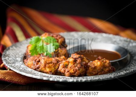 Indian vegetable pakoras served with a tamarind dipping sauce.