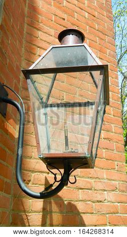 Exterior light fixture mounted on a brick church building.