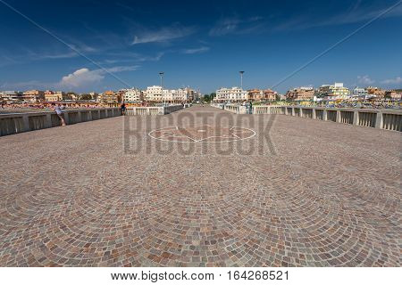 Lido di Ostia ITALY - September 14 2016: Relaxing people on the pier (Pontile Di Ostia) near beautiful beach Lido di Ostia ( Lido di Roma) Italy.