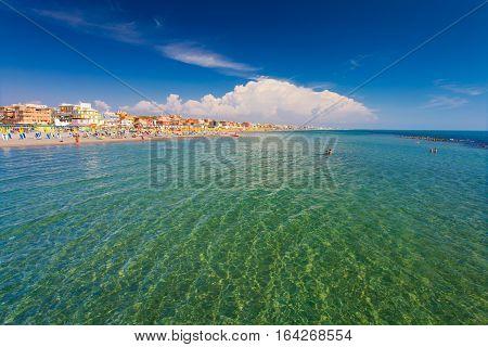 Lido di Ostia, ITALY - September 14 2016: Swimming and relaxing people on the beautiful beach Lido di Ostia ( Lido di Roma) private beach Battistini Italy.