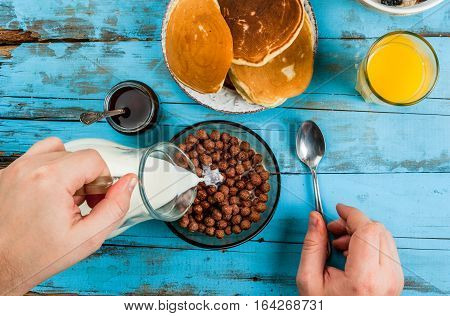 Man Having Breakfast With Cereal Chocolate Balls