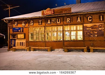SLOVAKIA TATRANSKA LOMNICA - JANUARY 05 2015: Traditional old half-timber restaurant in the building of the railway station. The town is known as skiing and hiking resort in High Tatras mountains.
