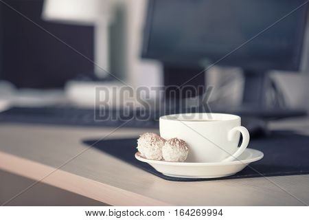 Cup with coffee on the workplace. Bussines concept and idea