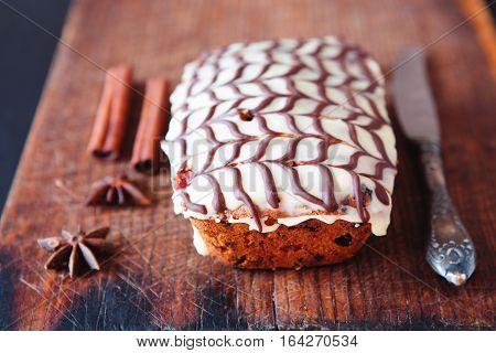 Fruitcake Decorated With White And Dark Chocolate