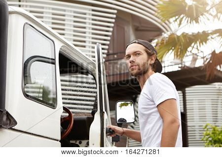 People, Nature And Transportation Concept. Young Hipster Smiling Happily, Opening Door Of His White