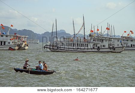 People Are Floating In Boat By Ha Long Bay, Vietnam