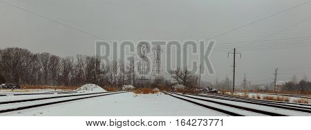 Railway covered with snow.Railroad winter morning.Railroad tracks in winter.The image of a winter view of the railroad tracks