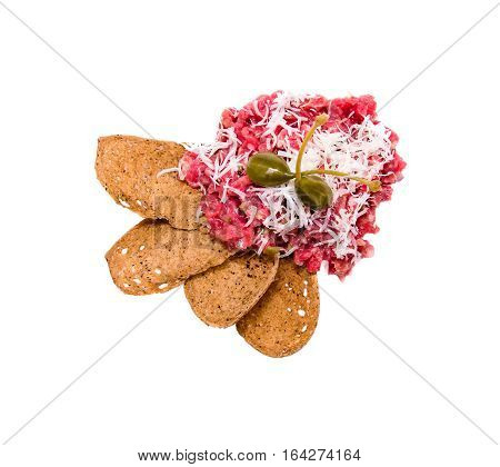 Top view beef tartare with capers bread crisps isolated on white background. Snacks appetizers meals flat lay composition from above. Healthy diet or lifestyle concept.