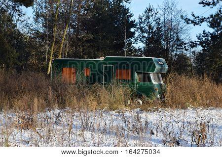 Camper van parked winter landscape . Sunny view of picturesque winter nature. Rural winter landscape under sunshine