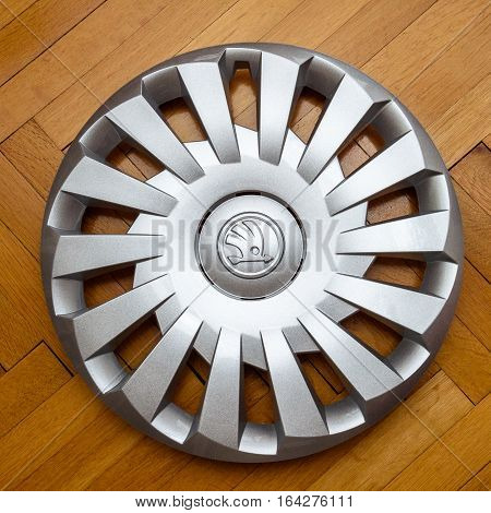 PARIS FRANCE - DEC 18 2016: Modern hubcap hub cover for the winter tyre made by Skoda Auto for Skoda Superb Skoda OCtavia and Skoda Roomster on wooden background