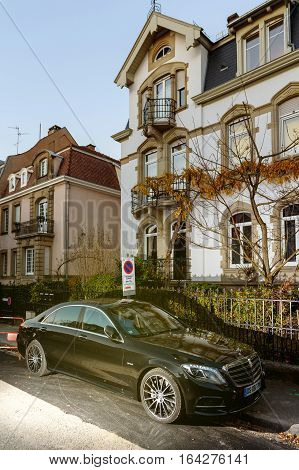 STRASBOURG FRANCE - NOV 29 2016: Luxury Mercedes-Benz S Klass limousine parked in front of a luxury house