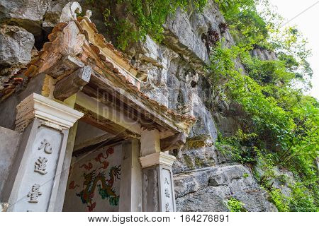 Entrance to a Buddhist cave temple in Vietnam with a dragon painting