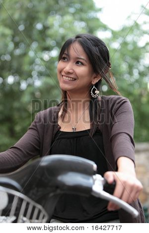 Young woman on a bicykle