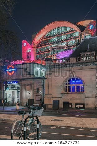 London, UK. 5th January 2016. Embankment rail station entrance and sign by the River Thames against the backdrop of Charing Cross station.