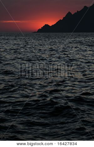 Sunset in UNESCO protected world heritage site of Scandola, Corsica poster
