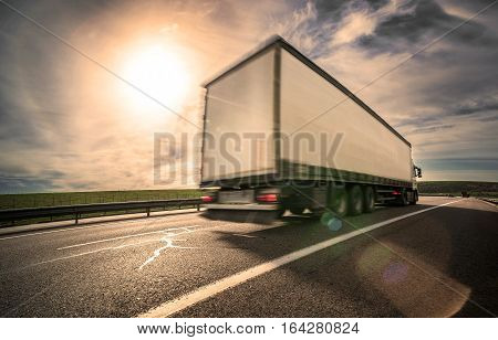 the cargo semi- truck in blurry motion