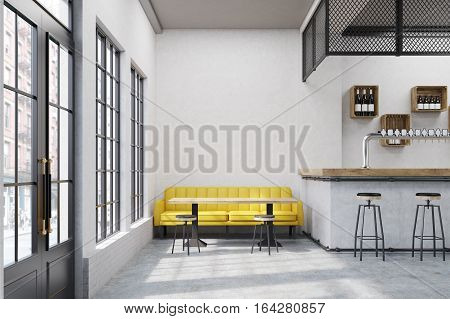Cafe with a large yellow sofa small tables and a bar. Large vertical poster on a concrete wall. 3d rendering. Mock up.