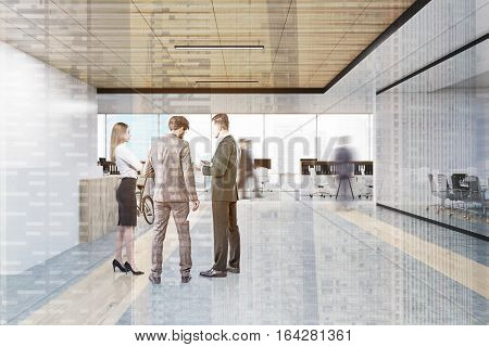 People talking in an office near a reception counter. A man is heading to the work area. Conference room is seen in the left part of the picture. 3d rendering. Mock up. Double exposure