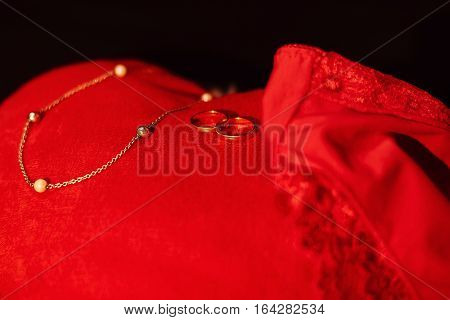 Red plush heart into wedding rings, hanging sexy panties