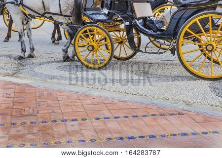 Coachman resting on his carriage at Plaza de Espana in Seville Andalusia Spain