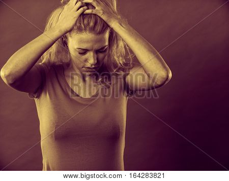 Negative human emotions headache face expressions mental disorders concept. Stressed frustrated depressed young woman in pain holding her head and hair