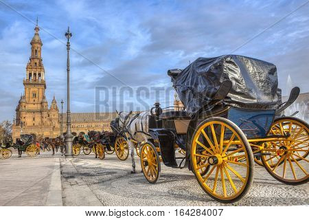 Parked Horse drawn carriages at Plaza de Espana in Seville Andalusia Spain. Spain Square