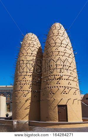 The pigeons sitting on poles of the birds towers in Katara Cultural Village in Doha, Qatar