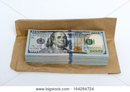 Stack of hundred dollar bills banknotes and envelope