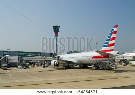 LONDON UK - JUNE 9 2016: An American Airlines Boeing 777 plane parked at Terminal 5 of London Heathrow Airport on a sunny morning in June.