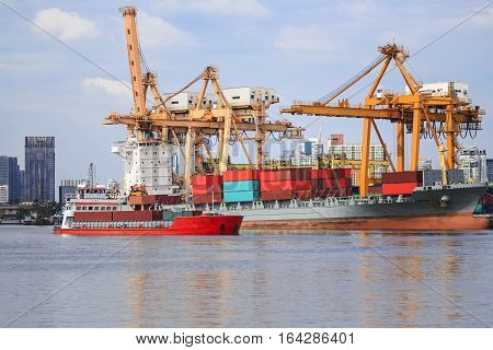 ship cargo containers and bulk cargo ship to harbor freight and yellow cranes