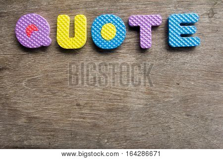 Colorful word Quote on old wooden background