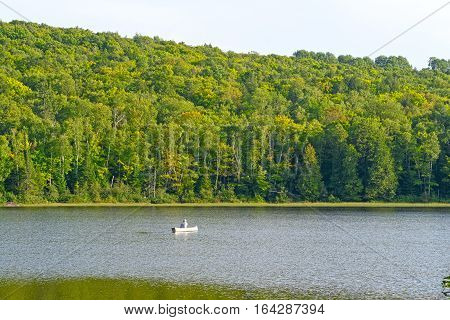 Canoer on a Quiet Lake on Lake of the Clouds in Porcupine Mountains State Park in MIchigan