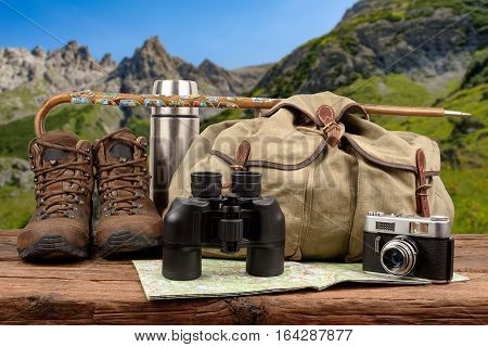 Hiking equipment backpack mountains in the background